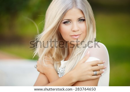 Fashionable young woman outdoors portrait glamour girl at city street Beautiful stylish female outdoor, soft focus, series photo - stock photo
