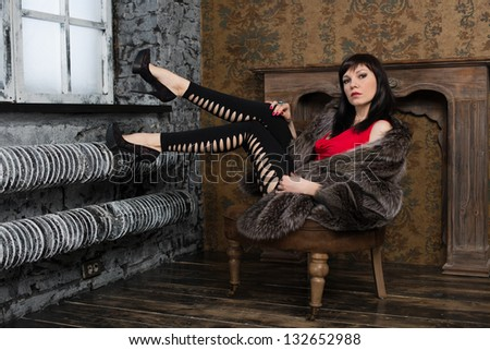 Fashionable young woman portrait in a vintage interior - stock photo