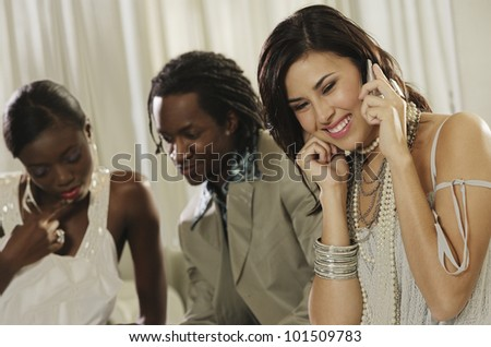 Fashionably dressed Hispanic woman talking on cell phone