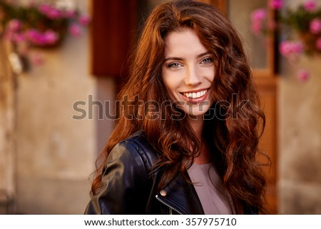 Fashionably dressed woman on the streets of a small Italian town - stock photo