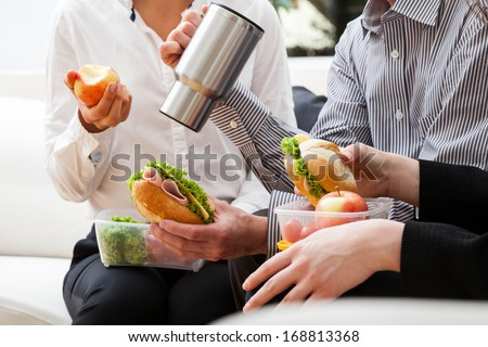 Fast break to eat second breakfast meal during work on project - stock photo
