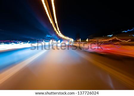 Fast car through city - stock photo