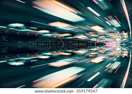 Fast cars on highway abstract