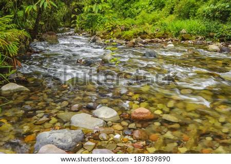 Fast flowing mountain stream near Bajos Del Toro Costa Rica. - stock photo