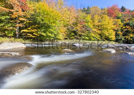 Fast flowing river during the autumn long exposure - stock photo