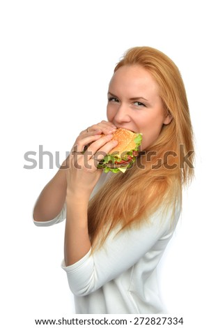Fast food concept. Woman eating tasty unhealthy burger sandwich in hands hungry getting ready to eat isolated on a white background - stock photo