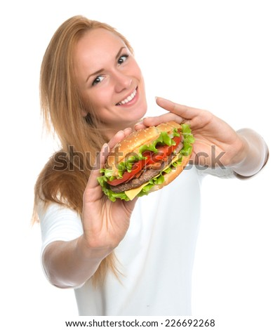 Fast food concept. Woman show tasty unhealthy burger sandwich in hands hungry getting ready to eat isolated on a white background - stock photo