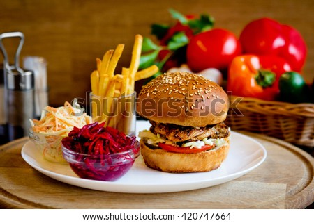 Fast food dinner with burger and salads in cafe