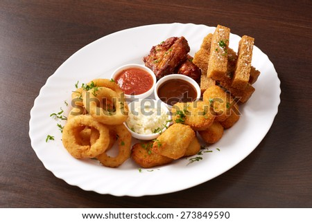 Fast food. Dish with snacks and sauces, close-up - stock photo