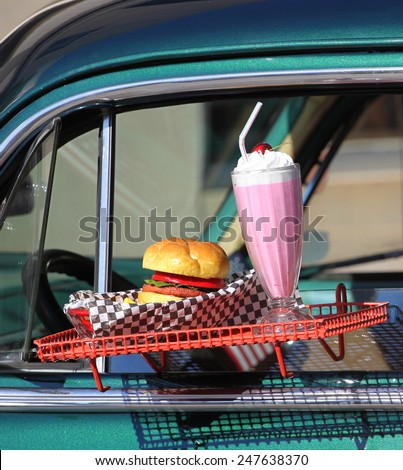 Fast food drive in diner with burger and shake. - stock photo