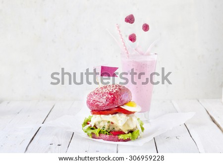 Fast food for girls - healthy chicken burger with beetroot bun