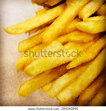 Fast food. Greasy and salty French fries. - stock photo