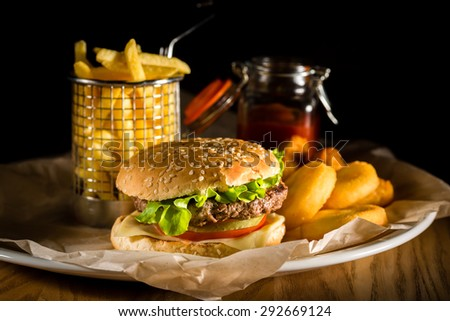 Fast food hamburger and french fries - stock photo
