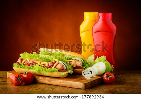 fast food hot dog menu with hotdogs, ketchup, mustard and vegetables - stock photo
