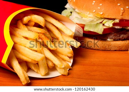 fast food set big hamburger and french fries on black background - stock photo