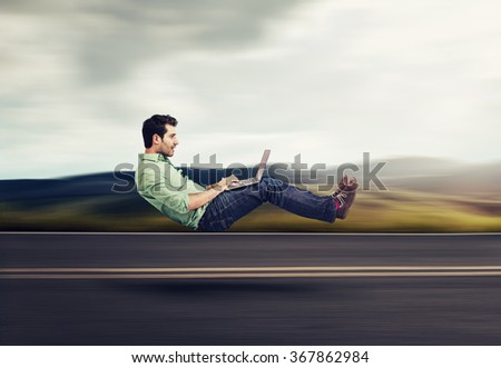 Fast internet concept. Autonomous self driving vehicle car technology. Levitating business man on road using laptop - stock photo