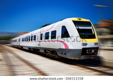 Fast modern  train with motion blur - stock photo
