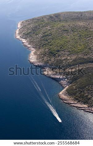 Fast motor boat near coast of island Brac on Adriatic sea in croatia - stock photo