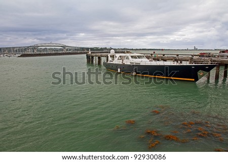 Fast motorboat on the background of the bridge port in Auckland