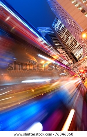 Fast moving bus at night - stock photo