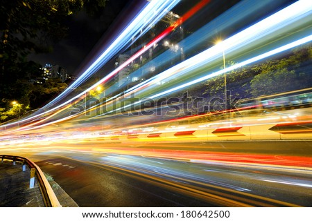 Fast moving car light on road at night
