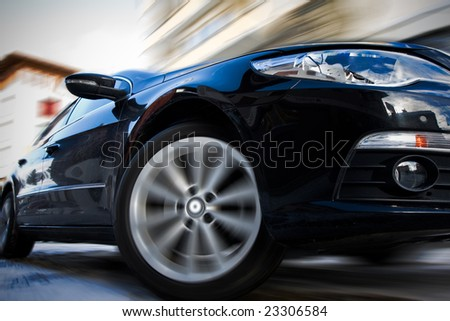 Fast moving car with motion blur - stock photo