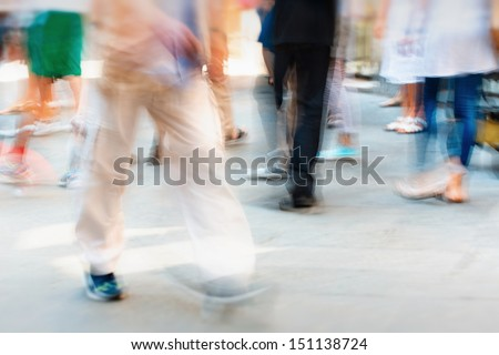 fast moving crowd on the sidewalk - stock photo