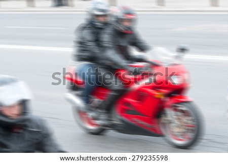Fast moving motorcycle racer blur background - stock photo