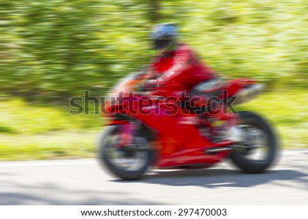 Fast moving motorcycle racer blur background