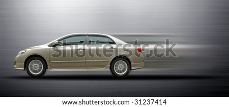fast moving saloon car - stock photo