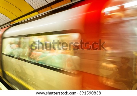 Fast moving subway train in London underground station. - stock photo