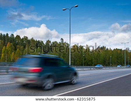 fast moving SUV car on highway - stock photo