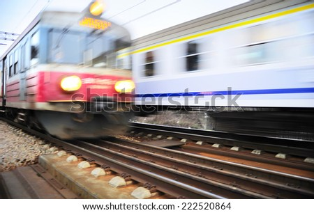 Fast moving trains in Krakow, Poland. Blured motion  - stock photo
