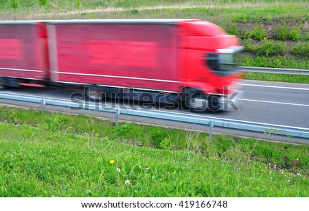 Fast moving truck quick transport transportation - stock photo