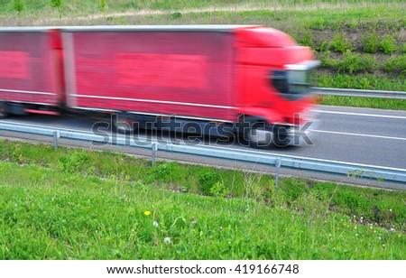 Fast moving truck quick transport transportation - stock photo