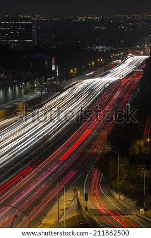 Fast night traffic on the San Diego 405 Freeway in west Los Angeles, California. - stock photo
