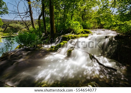 Fast river and waterfall in the Plitvice Lakes National Park.