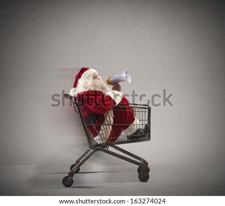 Fast Santa Claus announcement in a shopping cart - stock photo