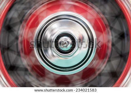 Fast spinning wheel of a car. Motion blur and fast speed.