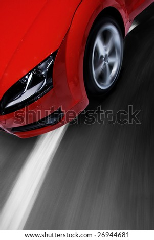 Fast sports car moving with motion blur and zooming effect