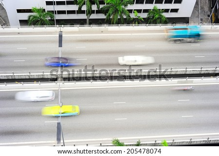 Fast traffic on a highway in Singapore. Long exposure  - stock photo