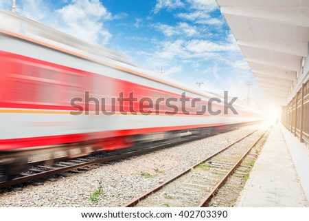 Fast train passing by. Motion blur - stock photo
