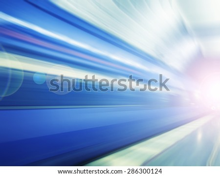fast train passing by,motion blur ,colorful train in the tunnel, abstract transportation background - stock photo