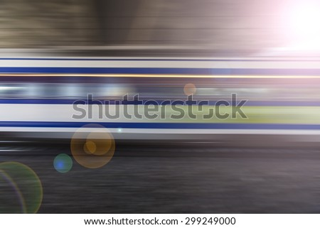 fast train passing by,speed motion blur background,fast train traveling at high speed  - stock photo