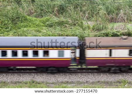 Fast train passing on a summer day (motion blurred image)