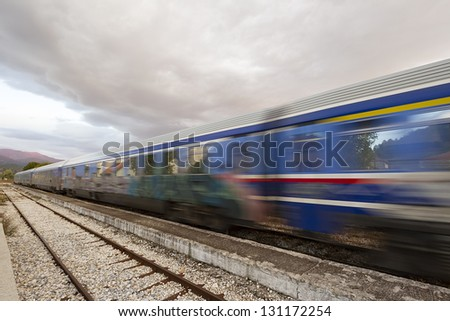 Fast train passing on railway station - stock photo