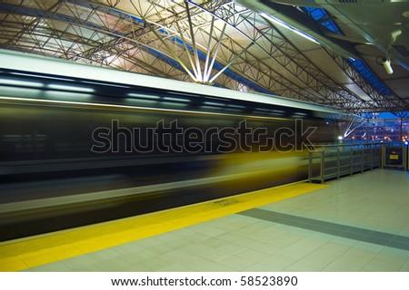 Fast train passing on railway station, Kuala Lumpur, Malaysia - stock photo