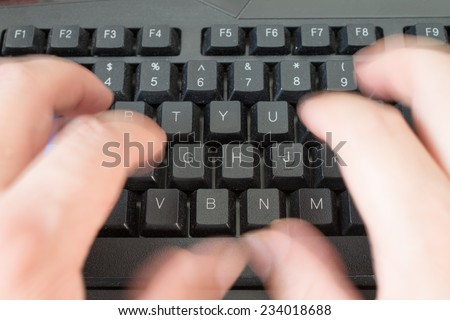 Fast typing on the keyboard - stock photo