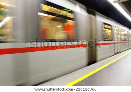 fast underground subway train while hurtling fast with commuters on board - stock photo