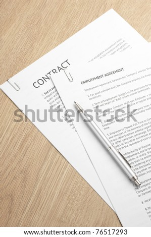 Fastened pages with legal documents and pen on wooden desk. - stock photo